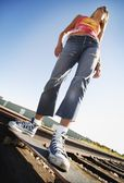 Woman On Skate Board On Train Tracks — Stock Photo