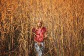 Girl Walking Through A Field — Stock Photo