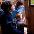 Stock Photo: Kids Peek Out Door