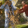 Father Throws Leaves At Son — Stock Photo #31678645