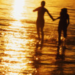 Stock Photo: Couple Hand In Hand In Water