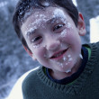 Stock Photo: Boy With Snow On His Face