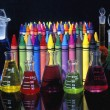Stock Photo: Wax Crayons And Measuring Flasks
