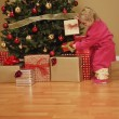 Stock Photo: Child Looking At Presents