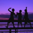 Three Silhouettes Of Boys On A Dock Against A Sunset — Stock Photo