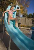 Sliding Down A Slide — Stock Photo