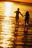 Couple Hand In Hand In Water — Stock Photo