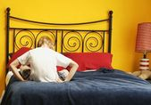 Child Sulks On Bed — Stock Photo
