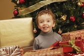 Child Under Christmas Tree — Stock Photo