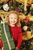 Child With Christmas Present — Stock Photo