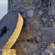 Stock Photo: Millstone Leaning Against Windmill Wall