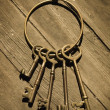 Stock Photo: Old-Fashioned Skeleton Keys Laying On Distressed Wood Floor