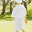 A Little Girl In A Bunny Costume With Her Back To The Camera. — Stock Photo #31681415