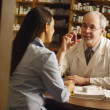 Pharmacist Giving Patient Medical Advice — Stock Photo