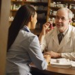 Stock Photo: Pharmacist Giving Patient Medical Advice