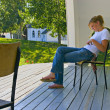 Teenager Sits On Deck — Stock Photo
