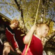Pushing Boy On Swing — Stock Photo