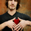 Man Holding Red Heart On His Chest — Stock Photo