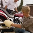 Stock Photo: Father And Son Shine Motorbike