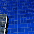 Stock Photo: Reflection Of High-Rise