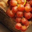 Stock Photo: Close-Up Of Red Grapes And Loaf Of Bread