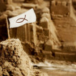 Stock Photo: Sandcastle With Flag