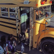 Children Loading A School Bus — Stock Photo #31686699