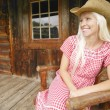 Stock Photo: Cowgirl Sits On Patio