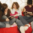 Stock Photo: Group Of Teenagers Reading Together
