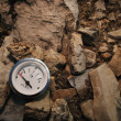 Stock Photo: Empty Gauge On Rocks