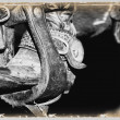 Stock Photo: Black And White Photo Of Cowboy Boot And Stirrup