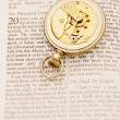 Stock Photo: Inside Of Pocket Watch On Bible