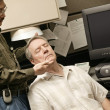 Stock Photo: Occupational Therapist Working With Senior Businessman
