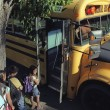 Stock Photo: Children Loading School Bus