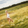 Teen Girl Walking Through Field — Stock Photo