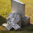 Stock Photo: Broken Headstone In Cemetery