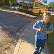 School Bus Drops Child Off — Stock Photo #31689953