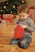 Child Opens Christmas Present — Stock Photo