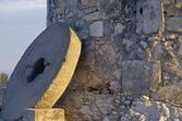 A Millstone Leaning Against A Windmill Wall — Stock Photo