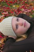 Young Woman Laying Back On Grass — Stock Photo