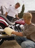 Father And Son Shine Motorbike — Stock Photo