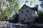 Stone House By The Riverbank — Stock Photo