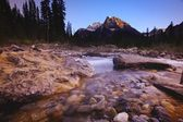 A Stream With Mountains In The Background — Foto Stock