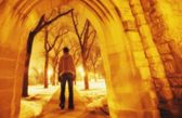 Person Strolling Through Arches — Stock Photo