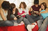 Group Of Teenagers Reading Together — Stock Photo
