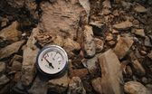 Empty Gauge On Rocks — Stock Photo