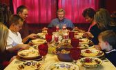 Family Praying Over Thanksgiving Meal — Stock Photo