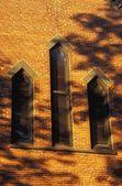Church Windows In A Brick Wall — Stock Photo