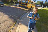 School Bus Drops Child Off — Stock Photo