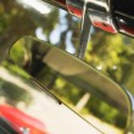 A Rear-View Mirror In A Car — Stock Photo